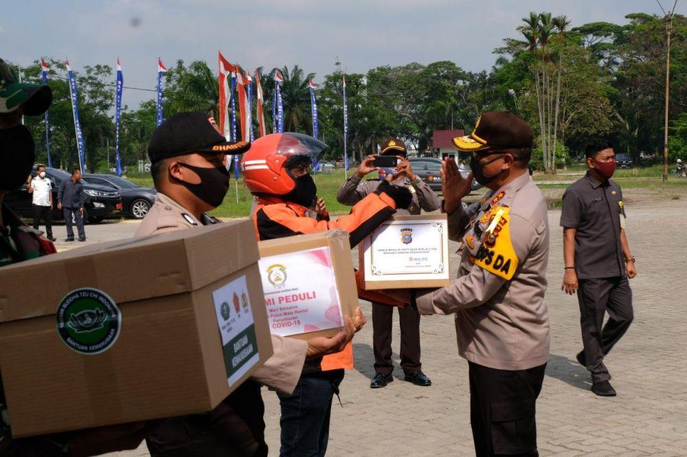 Gerakan Bhakti Sosial Serentak Polda Riau Peduli Covid-19