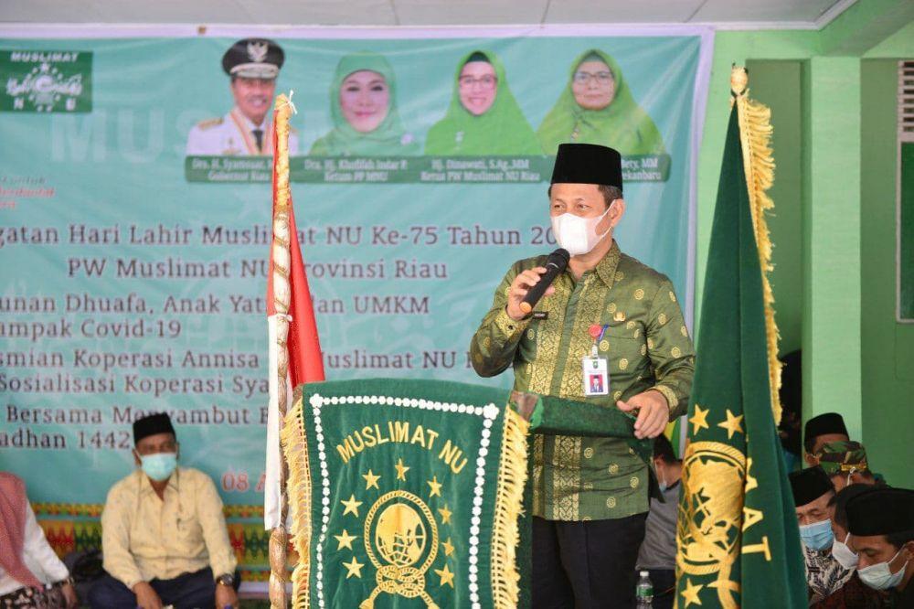Harlah Ke-75 Muslimat NU, Pj Sekdaprov Riau Bagikan Sembako dan Resmikan Koperasi