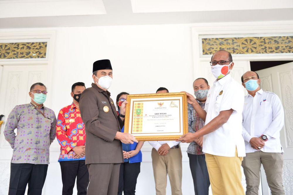 Pemprov Riau Terima Bantuan 126 Ribu Masker dari SKK Migas Sumbagut & K3S di Wilayah Riau
