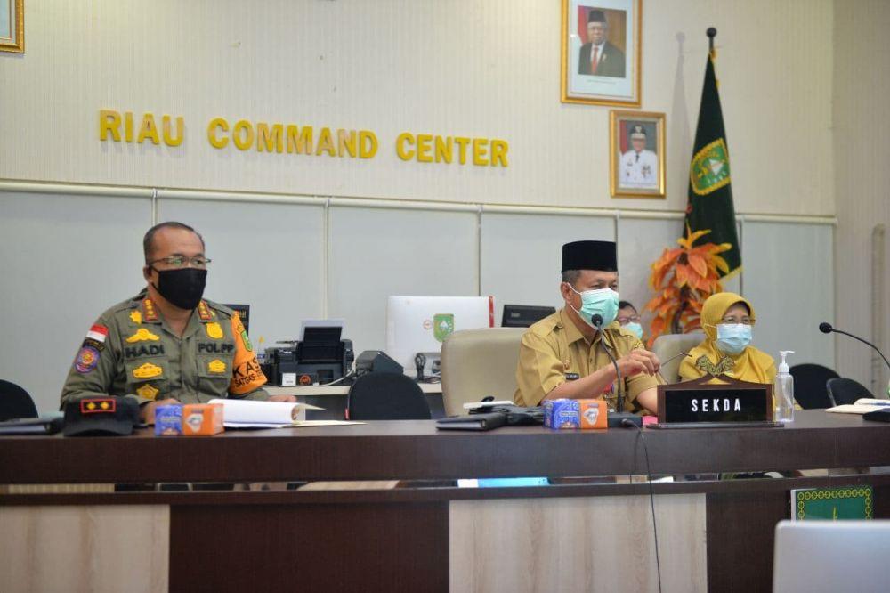 Plh Sekdaprov Riau Ikuti Rapat Sosialisasi PPKM Mikro Secara Virtual