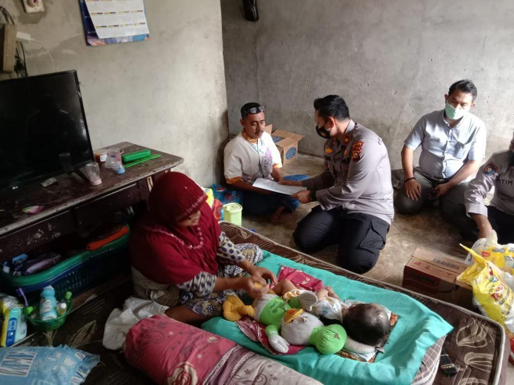 Wujud Empati dan Peduli Terhadap Sesama, Polsek Tualang Bantu Anak Penderita Hidrosefalus